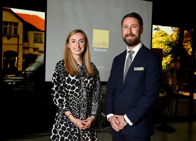 House prices in Wes Essex Savills Residential Research Analyst Gaby Foord with Loughton head of office James Lamb