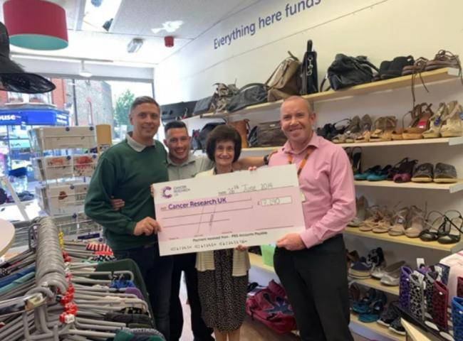 Selhurst Repair Shop colleagues Jon Dye, Tom Mills and Justin Lanigan with Jackie Lawrie, manager of Beckenham's Cancer Research shop