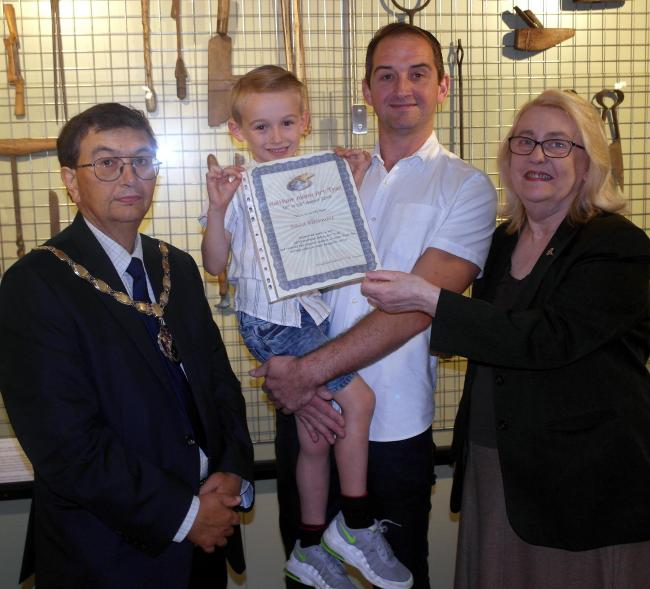 Winner Dave Birchmore with his son Ronny, Mayor of Waltham Abbey Cllr Antony Watts, and organizer of the art trail, Tricia Gurnett.