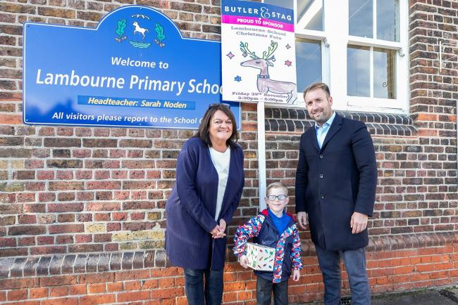 Lambourne Primary School student Dylan Sharpe with headteacher Sarah Noden Dylan Sharpe and Butler & Stag managing director Neil  Leahy