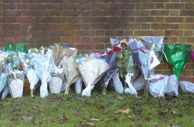 Flowers and tributes at the scene near Debden Park High School. Photo: Rick Findler/PA Wire