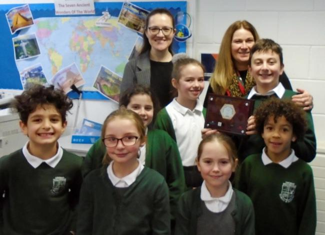 Students at Thomas Willingale Primary School and Nursery with their bronze plaque