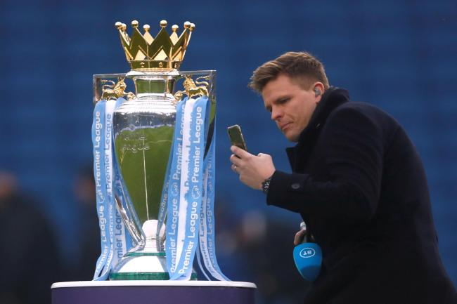 BT sport's Jake Humphreys with the Premier League trophy. Picture: Action Images