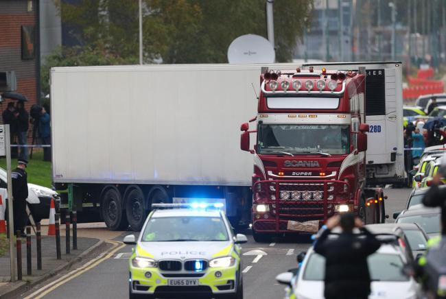 File photo dated 23/10/19 of the container lorry in which 39 people were found dead inside as is it driven away by police from Waterglade Industrial Park in Grays, Essex. Photo: PA Wire/Aaron Chown