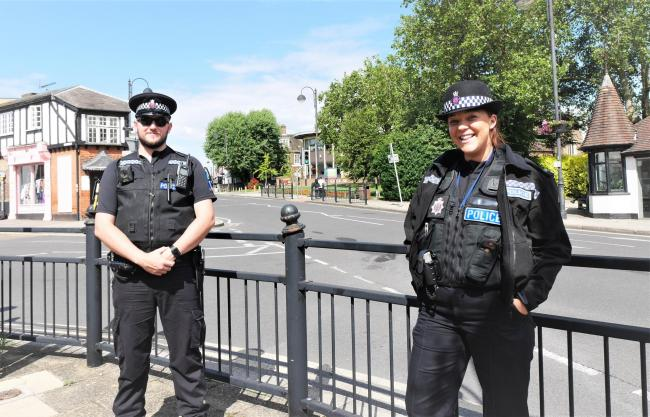 Essex Police's PC Luke Maskell and PC Charlotte O'Brien in Loughton High St. Photo: Essex Police
