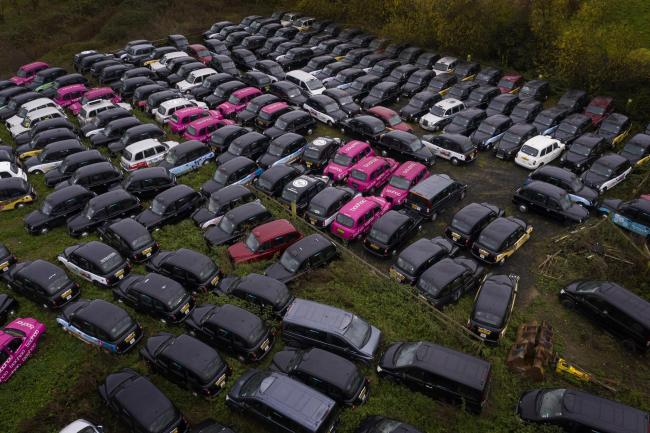 Over 200 unused black cabs parked in a large area of farmland in Epping Forest, which is being rented by GB Taxi Services to store their large fleet of London taxis that are no longer being used due to a severe drop in demand as coronavirus restrictions c