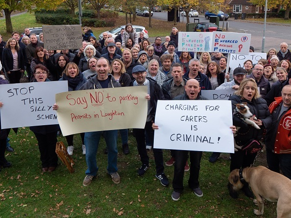 Protestors gathered in Loughton in opposition to the parking changes. Credit: Chris Shepherd