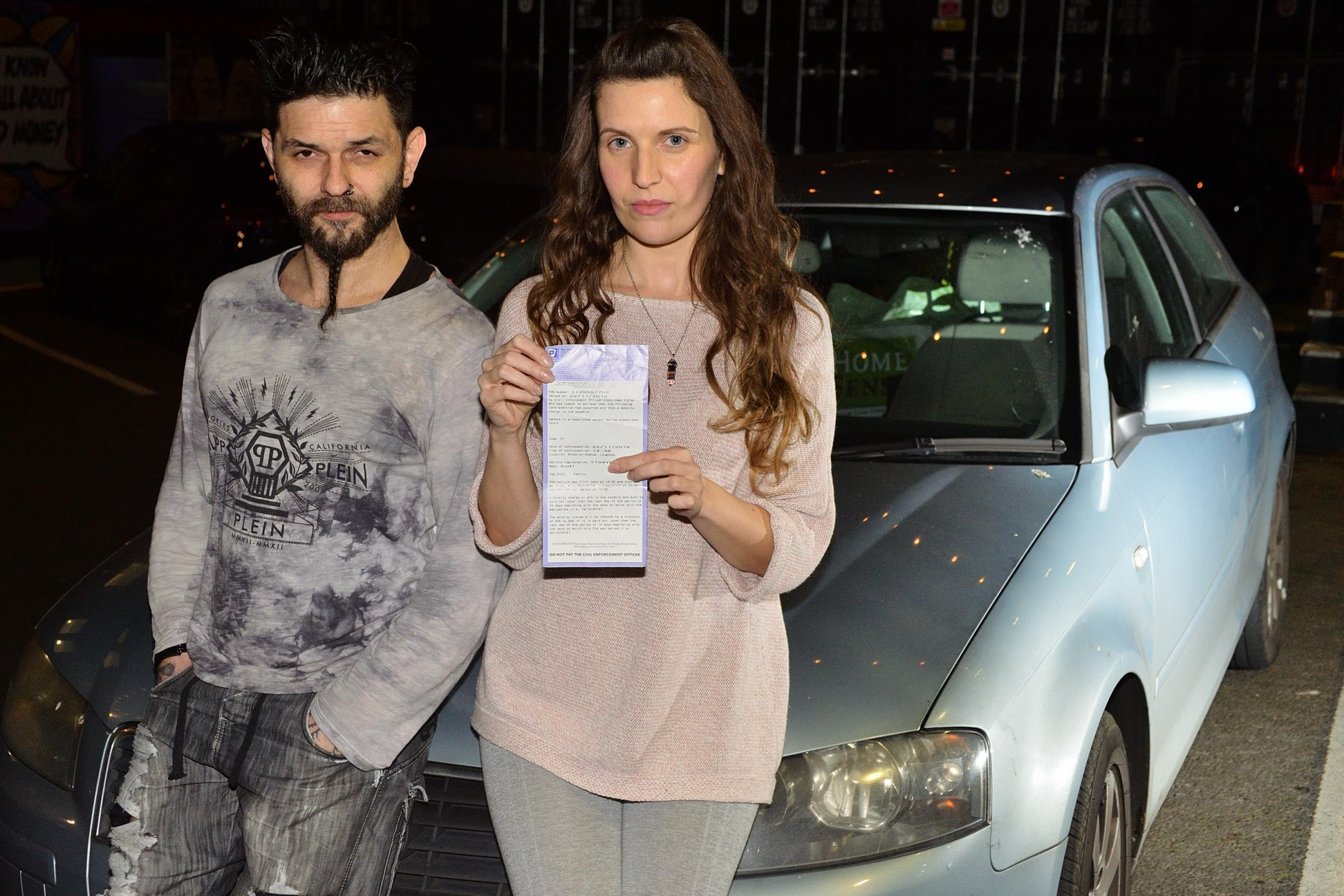 Leah Freet and Erx Yaman were issued a parking ticket after helping an elderly man who had collapsed at the roadside. Loughton, Essex.  (8-12-2019) EL92389_05