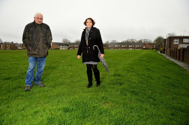 Roger Simister and Anne Kipp on the recreation field in Ninefields, Waltham Abbey where flats could be built. Essex. (12-3-2019) EL92470_04