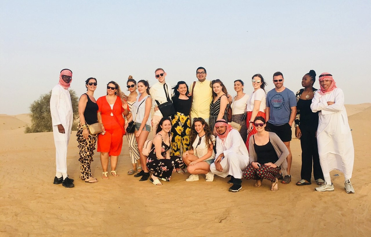 New City College's travel and aviation students  in the famous Dubai desert