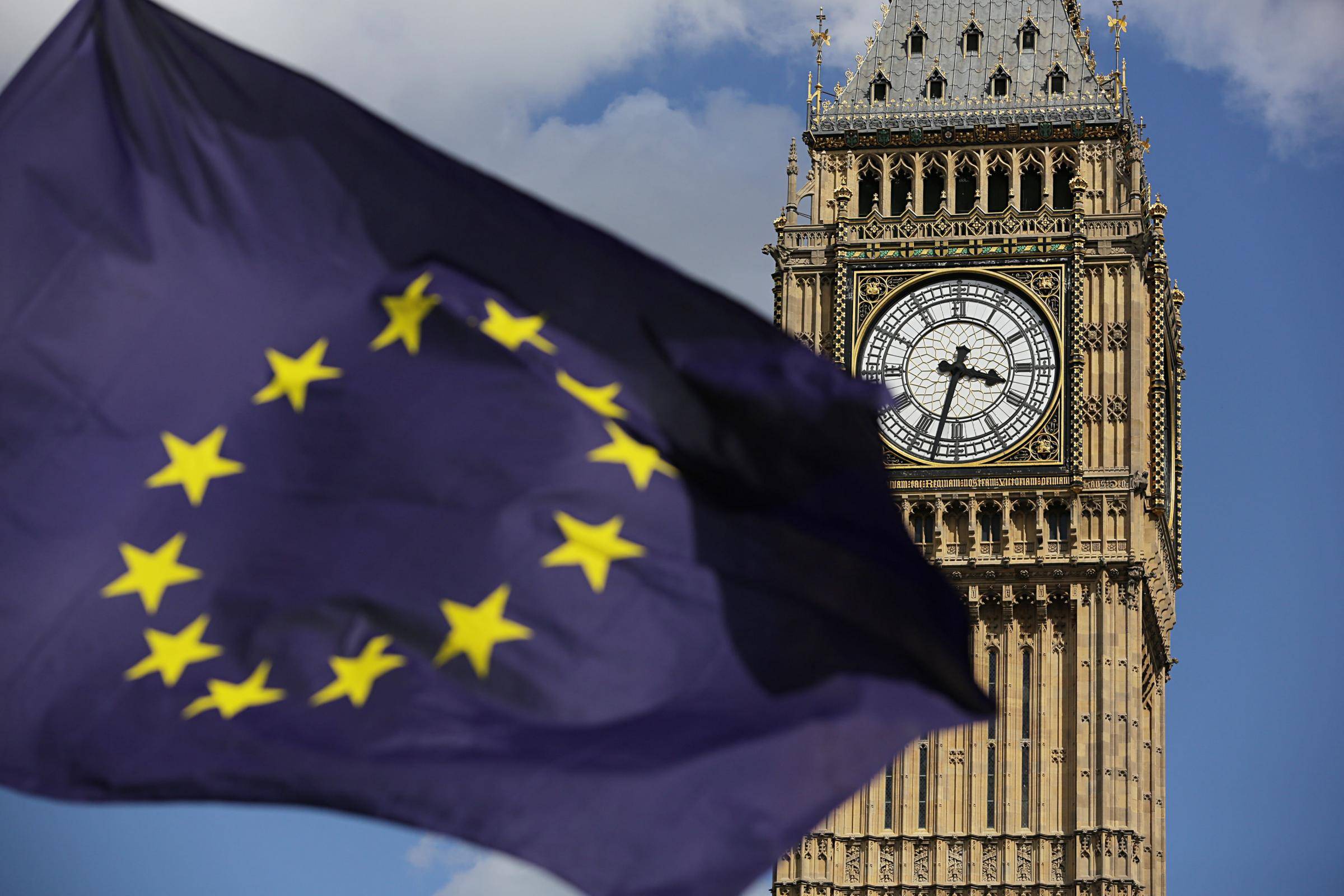 File photo dated 02/07/16 of a European Union flag in front of Elizabeth Tower in Westminster, as Parliament should be given a vote on triggering formal negotiations to take the UK out of the European Union, a committee of peers has concluded. PRESS ASSOC