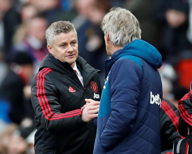 'Unlucky': Ole Gunnar Solskjaer shakes hands with Manuel Pellegrini at full-time. Picture: Action Images