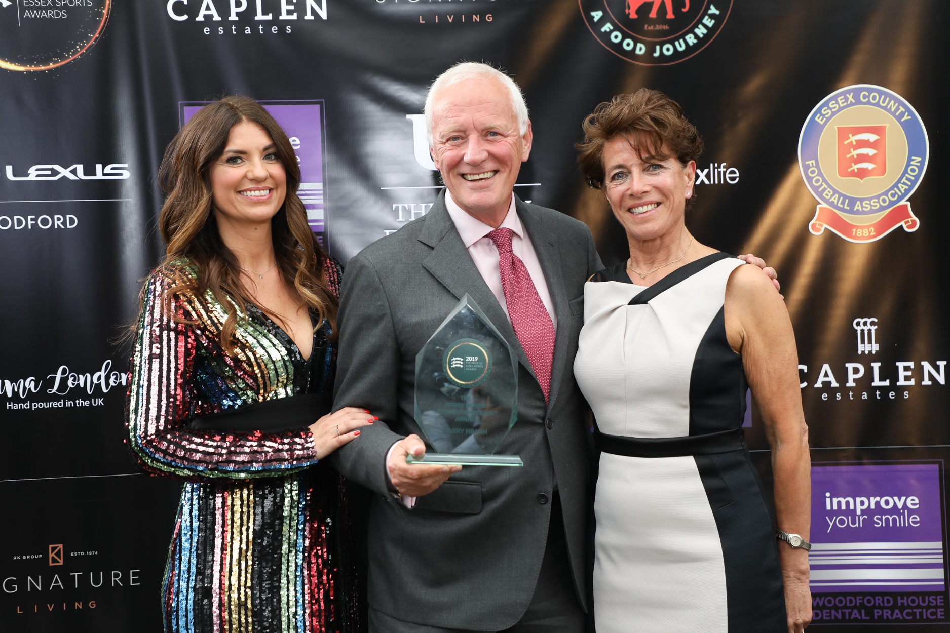 Barry Hearn with Bianca Westwood and Stephanie Moore MBE after receiving his Bobby Moore Lifetime Achievement Award at the inaugural Pride of Essex Sports Awards in Chigwell