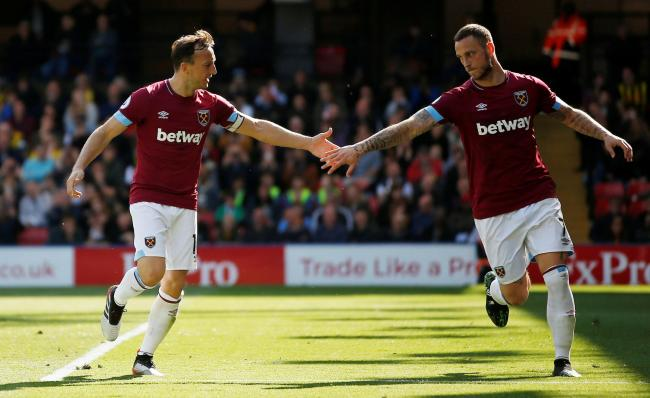 Marko Arnautovic congratulates Mark Noble after scoring the Hammers' fourth goal. Picture: Action Images
