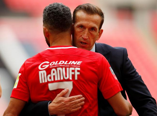 Justin Edinburgh and Jobi McAnuff at the FA Trophy final between Leyton Orient and AFC Fylde. Picture: Action Images