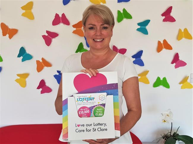 St Clare lottery manager, Paula Fogg, with brand-new Lottery leaflets